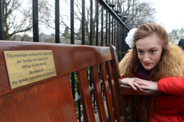 Lassie looking at Plaque on Muirfield bench