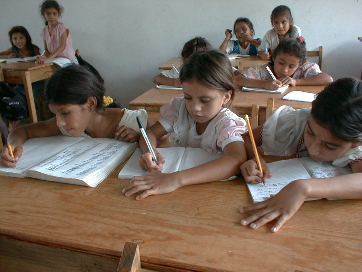 3 School Girls Writing