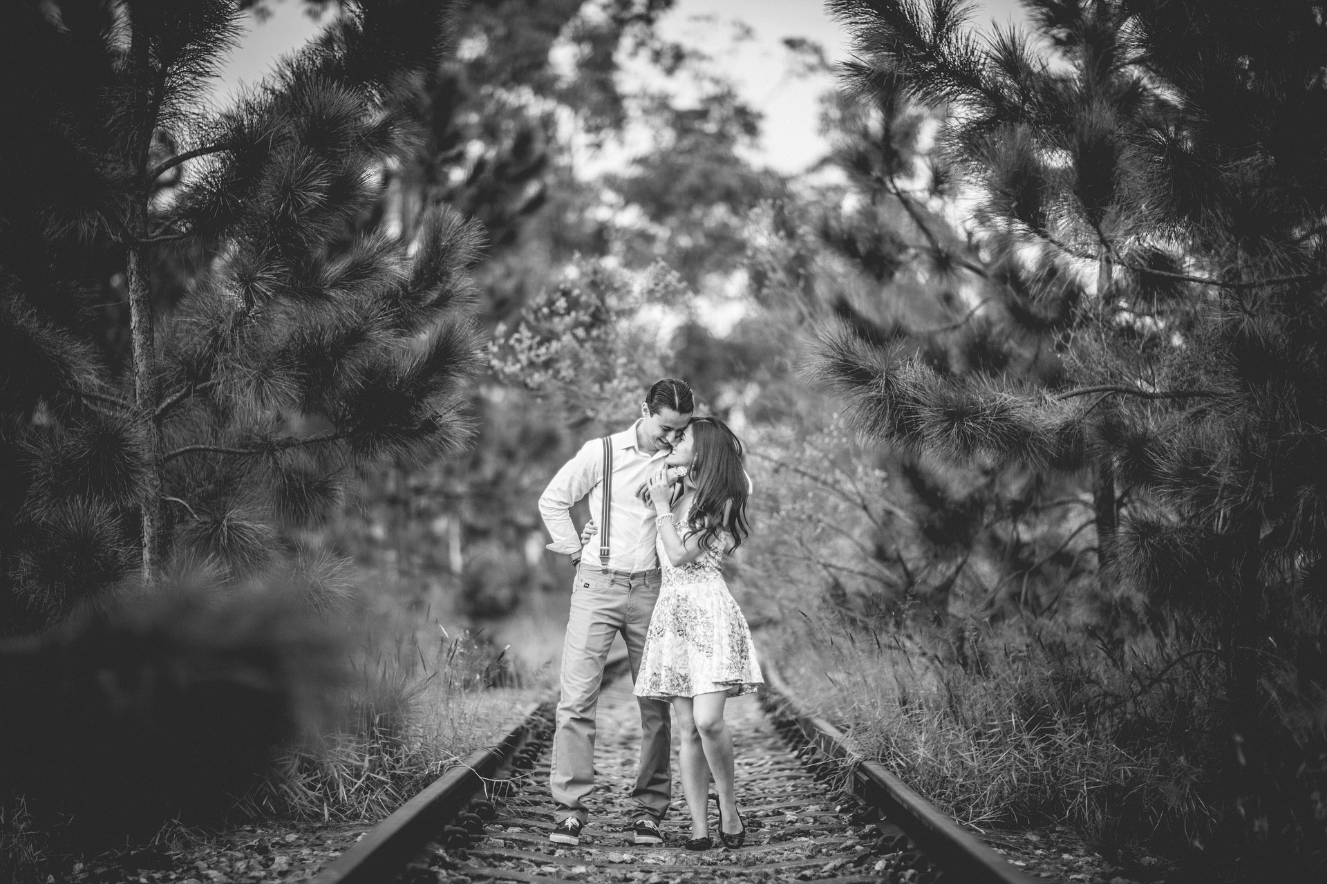 Couple in love on train tracks