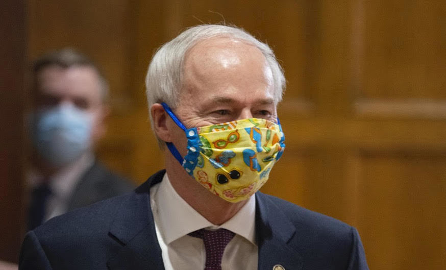 ASA Hutchinson wearing a mask